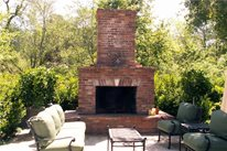 Backyard Brick Fireplace, Wood Outdoor Fireplace Outdoor Fireplace Grace Design Associates Santa Barbara, CA
