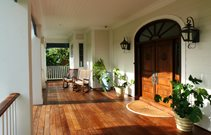 Wood Porch, Rocking Chairs, Arched Double Door, Lanterns Front Porch Landscaping Network Calimesa, CA