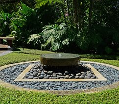 Pondless Fountain, Millstone Fountain, River Rocks Pond and Waterfall Lewis Aqui Landscape + Architectural Design, LLC. Miami, FL