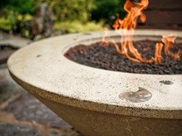 A conical fire pit made of polished concrete