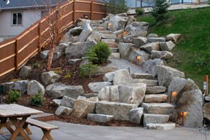 Boulder Stairs, Stair Lighting Backyard Landscaping Copper Creek Landscaping, Inc. Mead, WA