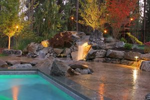 Waterfall Lighting Backyard Landscaping Copper Creek Landscaping, Inc. Mead, WA