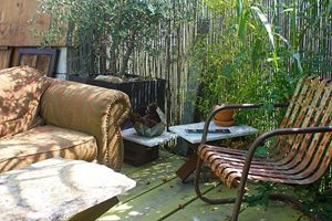 Rusty Chairs Are Prized Possessions In A Garden Embracing Wabi-Sabi. Retaining and Landscape Wall Janine Robinson ,