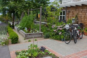 This Front Yard Is Enhanced By Its Display Of Vegetable Retaining and Landscape Wall Janine Robinson ,