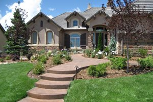 Informal Front Yard, Colored Concrete Walkway Swimming Pool Accent Landscapes Colorado Springs, CO