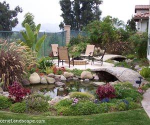 Backyard garden with pond and bridge