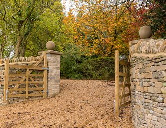 Rustic Gravel Driveway Swinging Gate Stone Walls Gates And Fencing Landscaping Network Calimesa