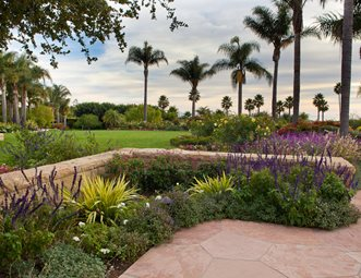 Stone Wall, Blooming Plants, Palm Trees Retaining And Landscape Wall Down  To Earth Landscapes