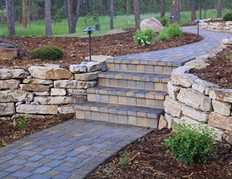 dry stack stone wall brown paver walkway walkway and path landscaping network calimesa ca - Paver Walkway Design Ideas
