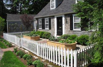Existing White Picket Fence Encloses Garden. Nilsen Landscape Design Boston, MA
