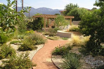 backyard xeriscape, pergola fireplace