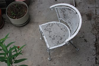 weathered wrought-iron chair