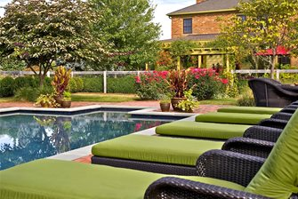 Green fabric on the all-weather wicker lounges