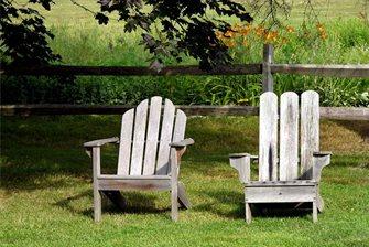 aged adirondack chairs