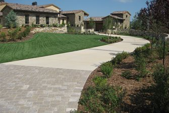 long driveway and stone retaining walls