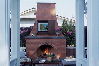 Outdoor brick fireplace landscaping network - Outdoor fireplace with tv ...