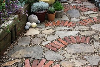 mosaic of recycled paving materials