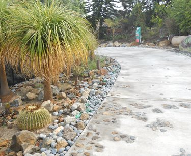 Concrete Driveway, River Rock, Embeds Landscaping Network Calimesa, CA