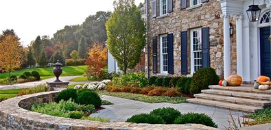 formal front yard stone wall urn