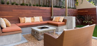 Square Stone Fire Pit, Concrete Cap, Buil In Bench Seating, Metal Pergola Fire Pit Studio H Landscape Architecture Newport Beach, CA