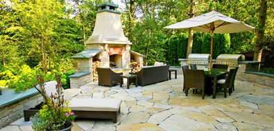 Backyard Fireplace, Flagstone Patio, Two Grills, Seat Walls Midwest Landscaping Romani Landscape Architecture Glencoe, IL