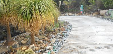 Concrete Driveway, River Rock, Embeds Asian Landscaping Landscaping Network Calimesa, CA