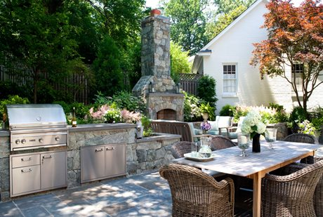 custom outdoor kitchen and fireplace
