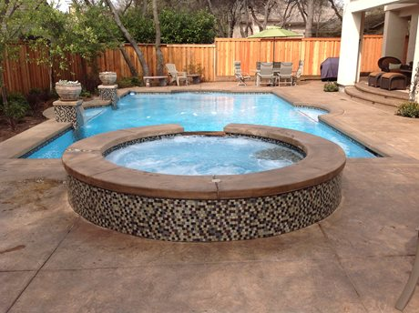 grecian pool and spa, stamped concrete