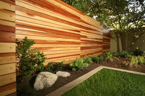 Modern Horizontal Wood Fence with Landscaping 500 x 332