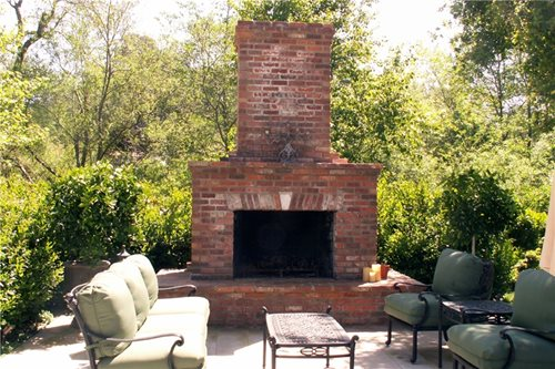 Four common styles of backyard fireplace designs including traditional