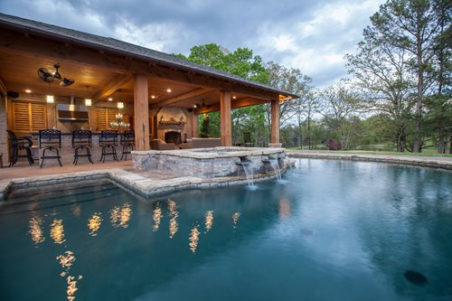 Rustic mississippi pool house landscaping network for Pool house designs with outdoor kitchen