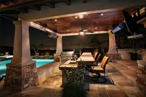 covering an outdoor kitchen with a roof allows indoor comforts and