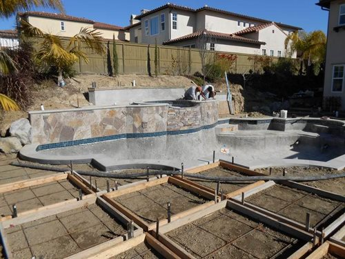 Backyard updates san marcos landscaping network for Pool design sloped yard