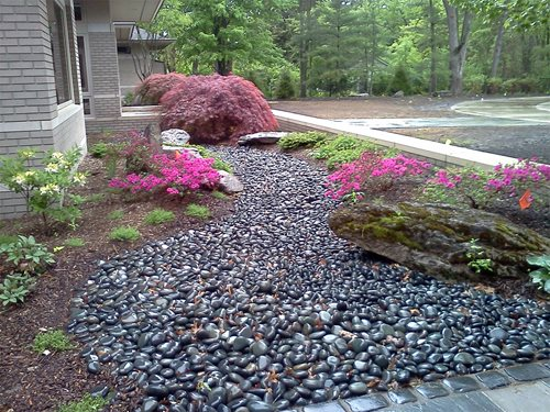 Asian inspired lakefront landscape landscaping network for Beach rocks for landscaping