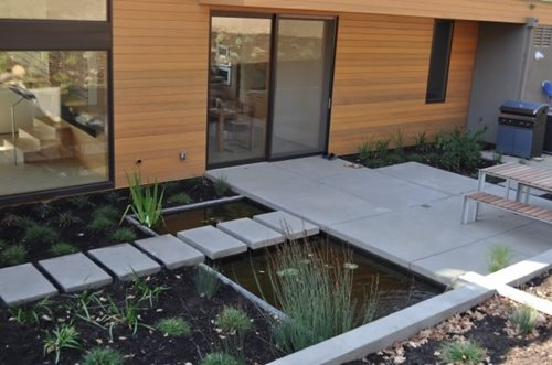 Concrete ponds often have a decidedly modern look Huettl Landscape