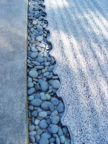 how to keep weeds out of gravel driveway