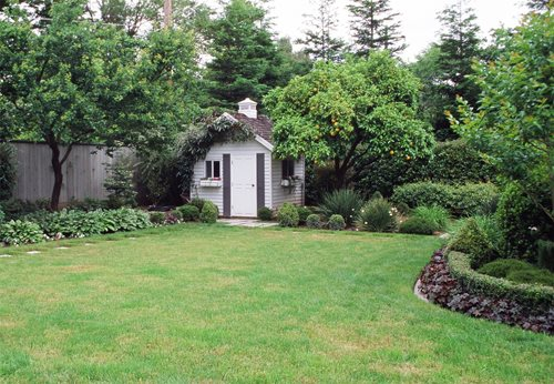 Backyard garden sheds landscaping network for Landscape ideas for small backyard with small shed