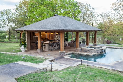 Rustic mississippi pool house landscaping network for Outdoor pool house designs