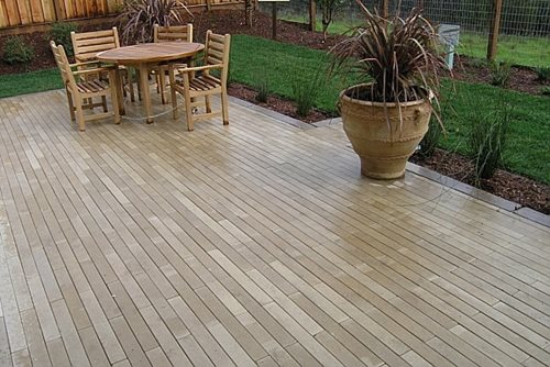 A Patio Made With One Color Of Narrow Modular Pavers.