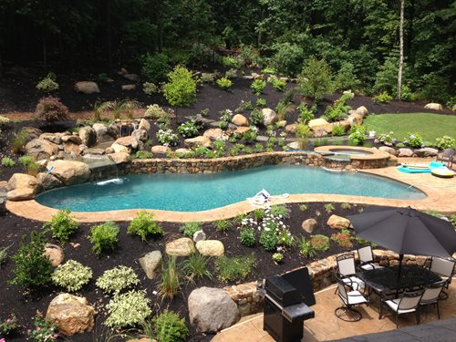 Hillside becomes statement making pool landscaping network for Pool design sloped yard