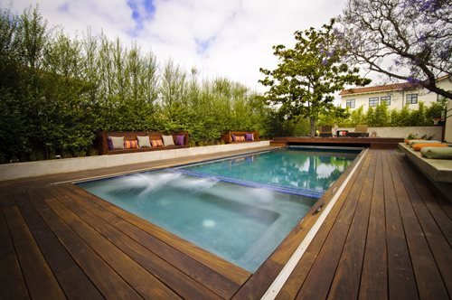 Automatic pool covers landscaping network for Pool deck landscaping