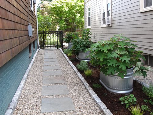 Side yard stock tanks landscaping network for Garden designs for side of house
