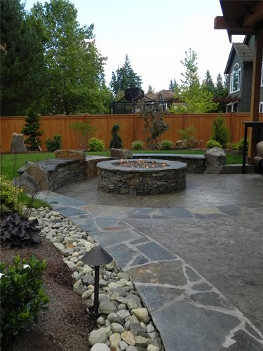 Stamped concrete mimics flagstone landscaping network for Walkout basement backyard ideas