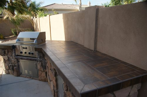 Best Tiles For Backyard :  concrete countertops were used in this small outdoor kitchen design