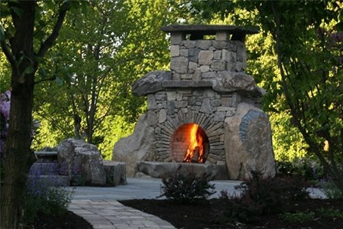 Information about using stone for the exterior façade of an outdoor fireplace.