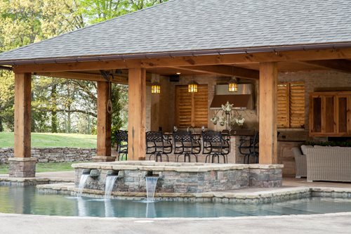 Rustic mississippi pool house landscaping network Pool house plans with bar