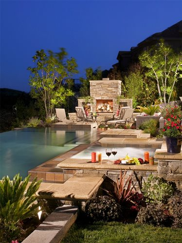 Wood burning outdoor fireplace landscaping network for Pool design studio