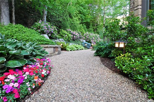 Pea Gravel Backyard Ideas : An existing natural stream behind the home was also bridged with hand