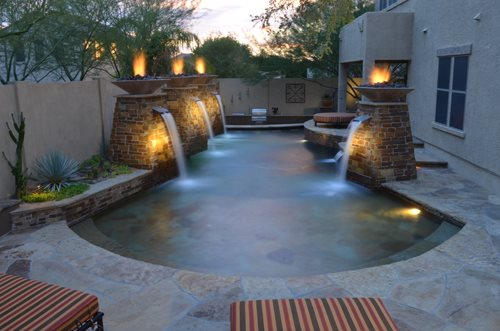 Fire and water elements landscaping network - Swimming pool fountain ideas ...
