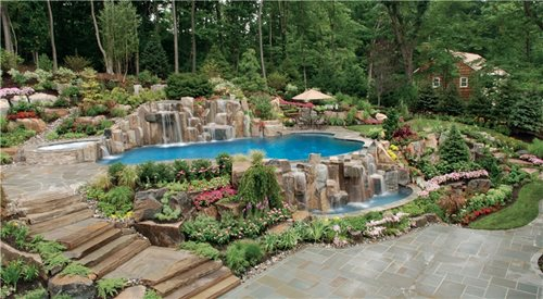 Waterfall Landscape Design Ideas stone pavers is the best way to cover the area around stone waterfall Outstanding Back Yard Swimming Pool Landscaping 500 X 275 39 Kb Jpeg